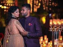 Sukriti and amrits glam delhi wedding   bride in peach Anarkali and groom in a blue suit with a red pocketsqaure