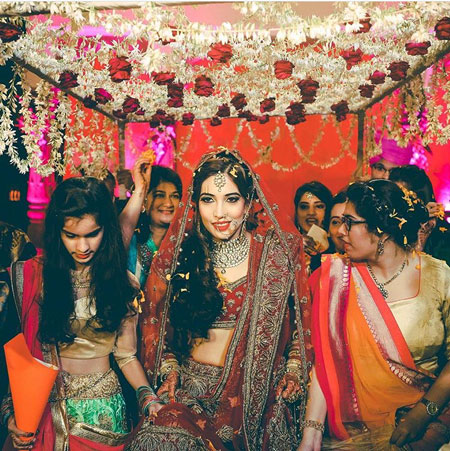 Indian bridesmaids duties | Bride's friends | BFF photos from Indian wedding | Indian bride and her friends under the floral hangings phoolon ki chadar