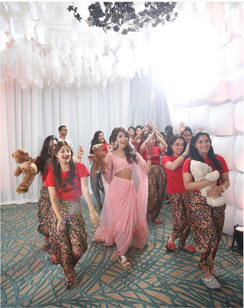Indian bridesmaids duties | Bride's friends | BFF photos from Indian wedding | bride with friends dressed in same night suits at sangeet | source axioo