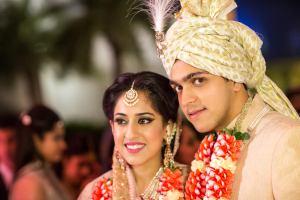 Ridhi Mehra wedding   Ridhi and akshay's Valentine's Day wedding   bride in pale pink Sabyasachi lehenga with Polki jewellery and groom in creme Rohit Gandhi sherwani