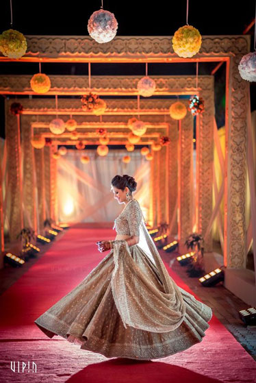 must have wedding pics for your wedding album | the bridal twirl photos | Indian bride in a grey gold lehengas with work all over
