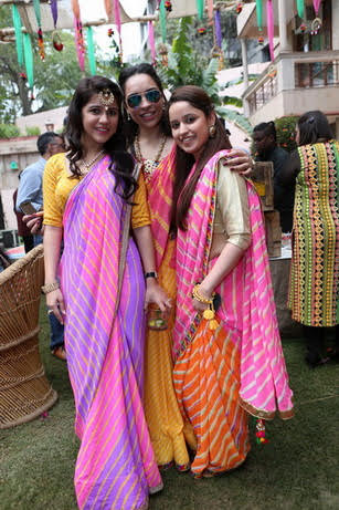 Sangini's bridesmaids in matching sarees gifted by the bride