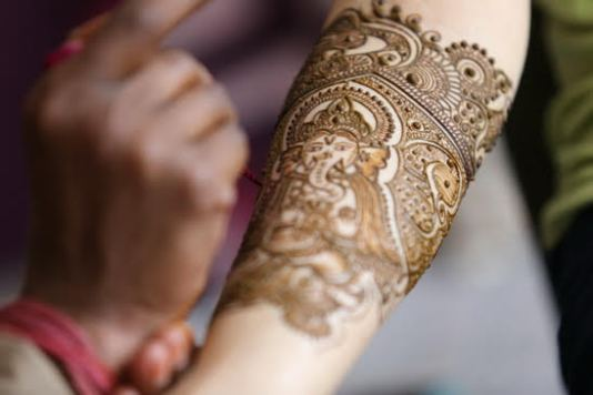 bridal Mehndi design with Ganesh ji in design