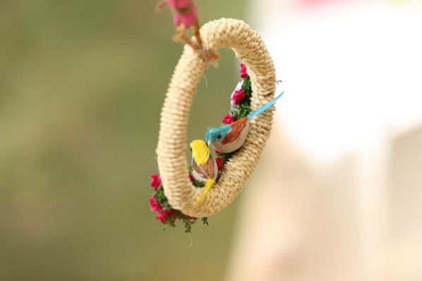 Pretty Kitsch Mehndi decor ideas |fresh Mehndi ideas | colourful yellow and pink birds decor
