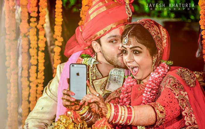 Indian couple with a camera phone | digital weddings | Digital Indai | Free honeymoon | Jayesh kathuria Photography | Witty Vows