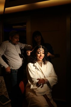 Sana-getting-ready-in-a-cruide-deck---bride-wearing-matahpatti