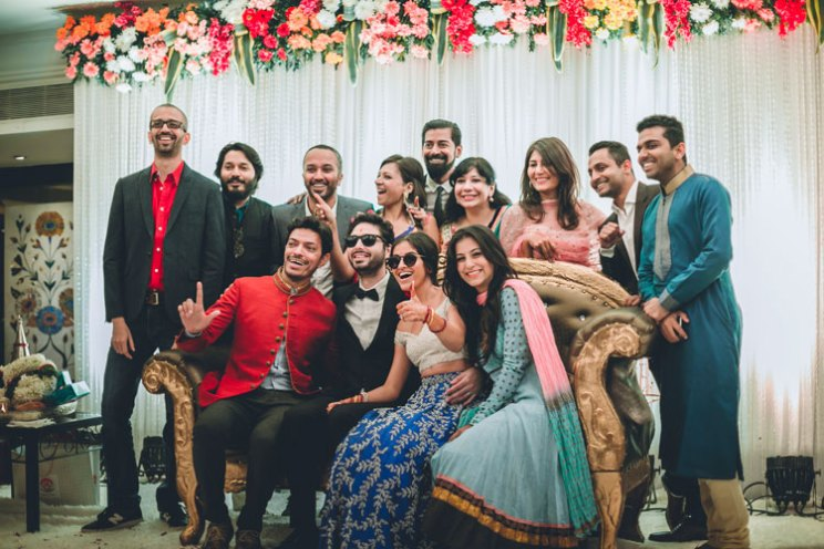 Indian biker bride | Bride in silver ivory off shoulder blouse and blue lehenga | loose bun with flowers | Rishad and Priyanka | Bride with her squad in sunglasses