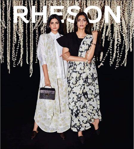 Rheson | Sonam Kapoor fashion | rhea Kapoor and Sonam Kapoor fashion brand | high street fashion | shoppers stop | Sonam Kapoor in fusion Indian wear | Sonam in a black cape saree blouse and a mogra saree