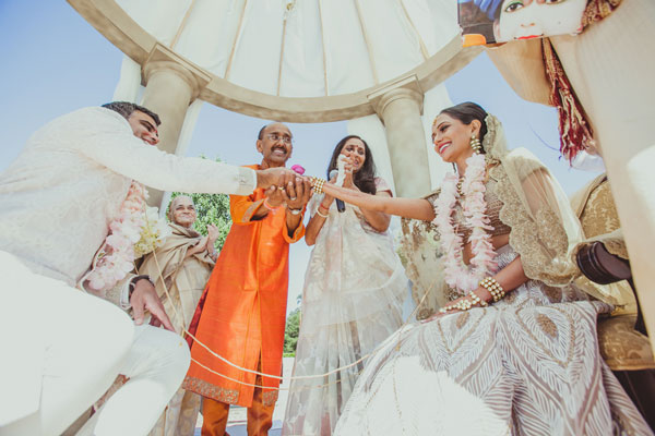 Indian bride's parents in the mandap during the ceremony