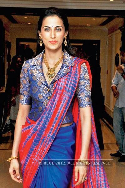 Latest blouse styles   new blouse styles to love   latest blouse designs for Indian brides   blue benarsfi blouse in jacket style paired with a red saree