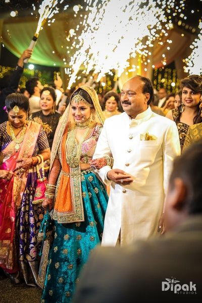 Wedding photos you must have with your dad | Indian bride photos with the feather of the bride | must have wedding photos | Indian bride walking to the mandap in a yellow lehenga and peach blouse | Day wedding | Brides father walking her to the vedi with sparklers and hand held gerbs