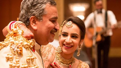 Wedding photos you must have with your dad   Indian bride photos with the feather of the bride   must have wedding photos   Indian bride walking to the mandap in a yellow lehenga and peach blouse   Day wedding   Indian Bride with her father at her wedding   Indian bride in peach lehenga with gold kaleeras