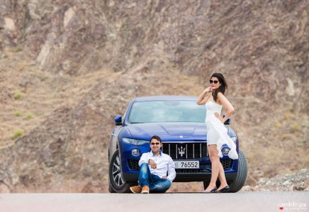 first anniversary idea, anupriya and ankit, aniversary photoshoot   Indian couple photoshoot in Dubai with a blue sports car