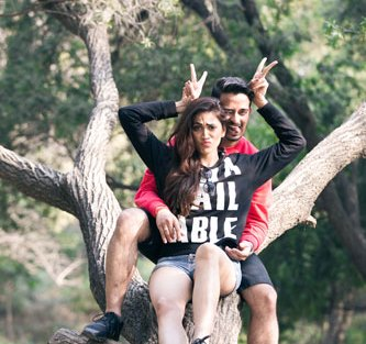 JyotPriya and Nishant | Punjabi wedding in Delhi | The couple together having fun and giving poses on tree branches.