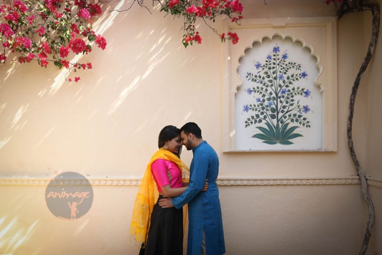 Anukriti and Siddharth | Delhi Wedding full of simple nd fun wedding ideas | Photo by AnImage Productions | Udaipur pre wedding shoot | bride wearing yellow dupatta with pink blouse and groom wearing a blue kurta | pre wedding shoot in Udaipur