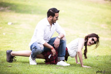 JyotPriya and Nishant | Punjabi wedding in Delhi | The guy watching over his girl while she tries her hands at push ups.