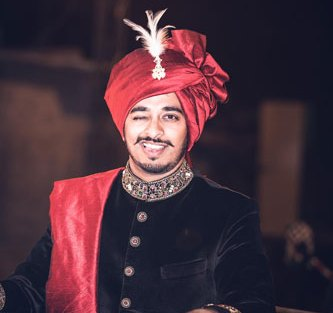 JyotPriya and Nishant | Punjabi wedding in Delhi | The dapper groom in black sherwani on his way to baraat.