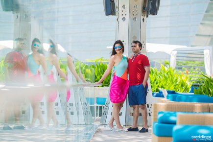 first anniversary idea, anupriya and ankit, aniversary photoshoot   Indian couple photoshoot in Dubai by the poolside in shorts and a sarong