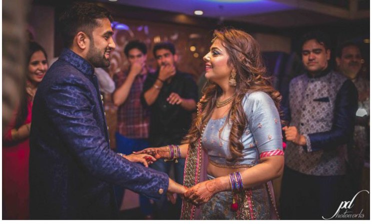 Divya and Balraj | Workplace romance turns in to a cute engagement ceremony | best friend romance | bride in a powder blue ombre lehenag with red and gold embroidery and groom in a blue sherwani with a gold salwarr and pocket square | ring ceremony | couple dancing at their engagement