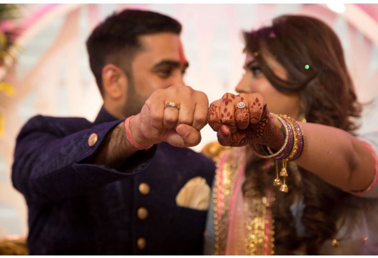 Divya and Balraj | Workplace romance turns in to a cute engagement ceremony | best friend romance | bride in a powder blue ombre lehenag with red and gold embroidery and groom in a blue sherwani with a gold salwarr and pocket square | ring ceremony | ring pose