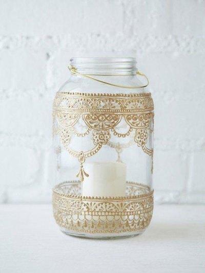 Teej party ideas   Teej Celebrations   Indian Mehendi design favours   henna design mason jar in gold   mason jar tight holder