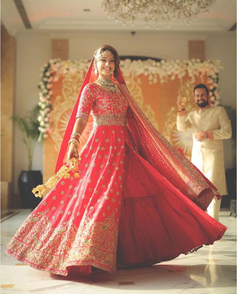 New lehenga styles, Gorgeous lehenga ideas, Unique lehengas |Indian bride wearing a pretty light red lehenga with 3 layers