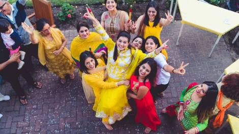 Wedding dance songs | wedding choreography videos to use | easy indian wedding choreography | Indian bride with her friends lifted in yellow | happy bride | haldi at home | Photo by Dream Diaries | Yellow suit for bride | Sangeet performances made easy