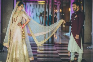 .Indian bridal Photos | Delhi Wedding | Kiah and Ron | Indian bride in a pretty blush lehenga with the groom in a marsala wine sherwani