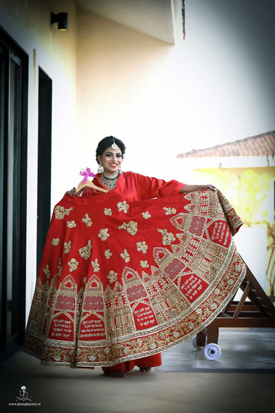 Nindiya and Nirmal | Indian bridal lehenga | Real flower lehenga | The bride with her beautiful red and gold bridal lehenga which had seven vows embroiderd on it.