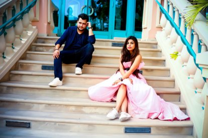 Nindiya and Nirmal | Indian bridal lehenga | Real flower lehenga | The couple posing in a cute , quirky look with their sneakers on.