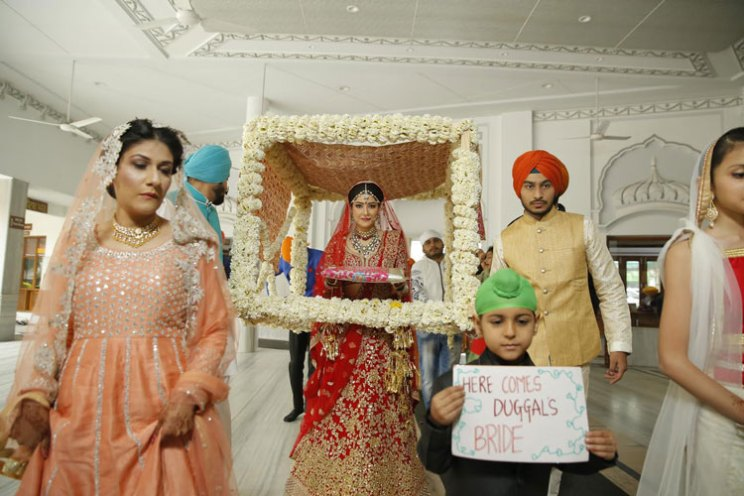 Fun Punjabi wedding ideas | Raagini and Gurtej - pretty wedding story | The cute bridal entry with a flower doli is beautiful.