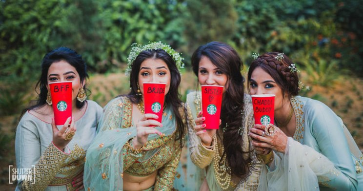 Squad accessories for Indian Weddings | Team bride metallic Badge that you can use | Ideas for the bride's side bridesmaids | team bride with Starbucks cups that have their relationships on them | Indian bridesmaids photoshoot idea