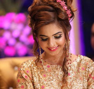 Roka ceremony in delhi, Raveena and Dipanshu | Indian bride to be in a gold sequin gown with a pretty floral top bun