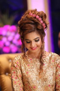 Roka ceremony in delhi, Raveena and Dipanshu   Indian bride to be in a gold sequin gown with a pretty floral top bun