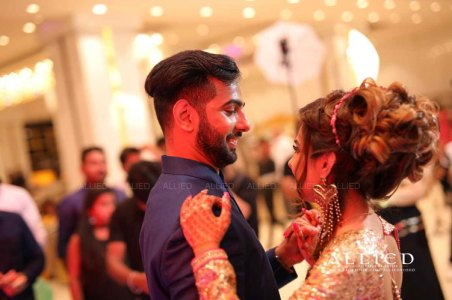 Roka ceremony in delhi, Raveena and Dipanshu   Indian bride to be in a gold sequin gown with her fiancé in a blue suit dancing