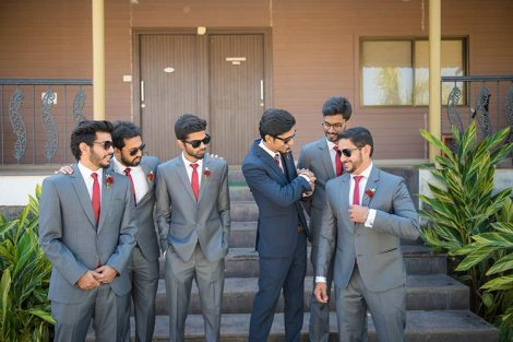 Joshua and Shona | Christian wedding | DIY ideas | The gang of boys in grey tuxedo having a fun time with the groom in blue tuxedo.