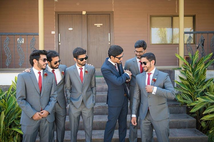 Joshua and Shona   Christian wedding   DIY ideas   The gang of boys in grey tuxedo having a fun time with the groom in blue tuxedo.