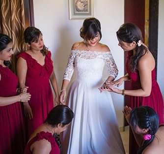 Joshua and Shona | Christian wedding | DIY ideas | The bridesmaids helping the bride get ready.