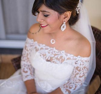 Joshua and Shona | Christian wedding | DIY ideas | The beautiful bride in an offshoulder white gown and diamond jewlry.
