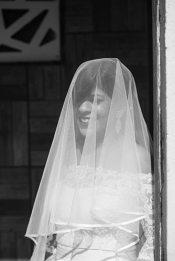 Joshua and Shona   Christian wedding   DIY ideas   The bride smiling behind her net sleeves.