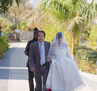Joshua and Shona | Christian wedding | DIY ideas | The bride walking down the aisle with her father.