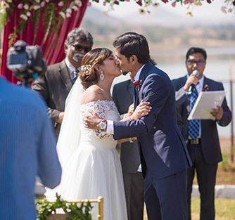 Joshua and Shona   Christian wedding   DIY ideas   The bride and the groom sharing their wedding kiss.