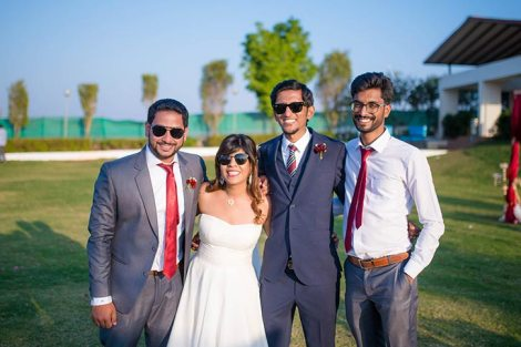 Joshua and Shona   Christian wedding   DIY ideas   The bride and groom posing and smiling with their friends.