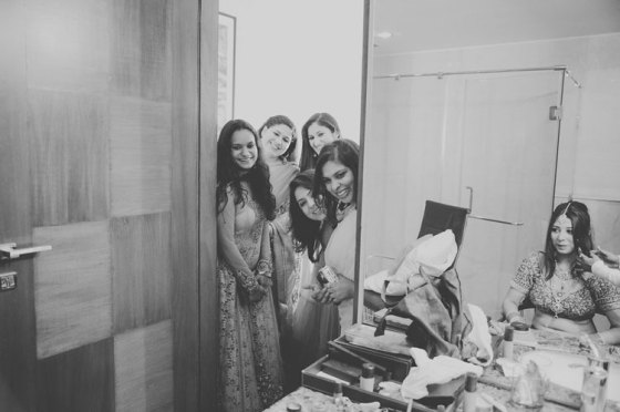Nimisha and Hemant | Temple wedding in Delhi | The bridesmaids trying to get a sneak peek of the bride.
