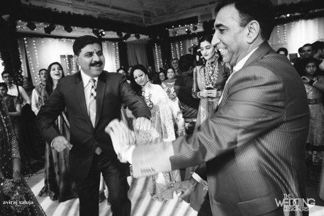 Jaya and Anish   Roka ceremony   Flower decor   The family dancing and having fun.