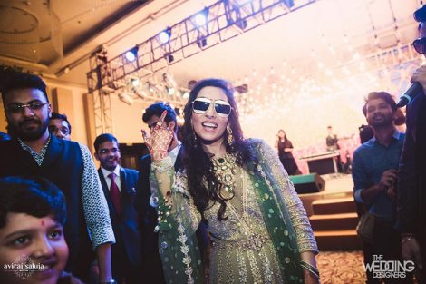 Jaya and Anish | Roka ceremony | Flower decor | The bride with her shades on dancing and having a gala time.