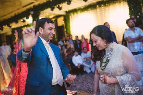 Jaya and Anish | Roka ceremony | Flower decor | The family happily shaking a leg at the roka ceemony.