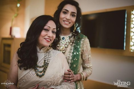 Jaya and Anish | Roka ceremony | Flower decor | The bride posing and smiling with her mother.