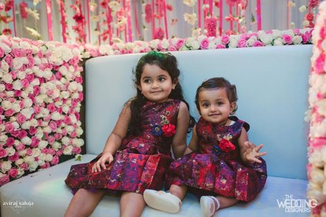 Jaya and Anish | Roka ceremony | Flower decor | The cute children sittting together in matching oufits.