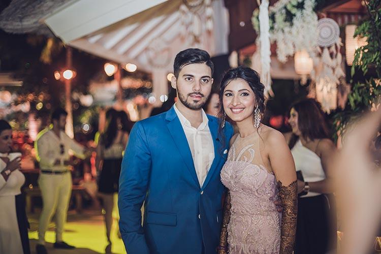 Sagar and Subiya   Destination wedding in Bali   The bride with her mehendi posing with her dapper groom.